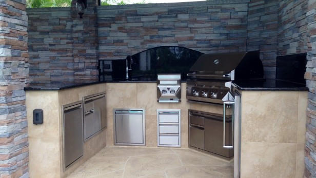 New roof addition features summer kitchen stacked stone walls and