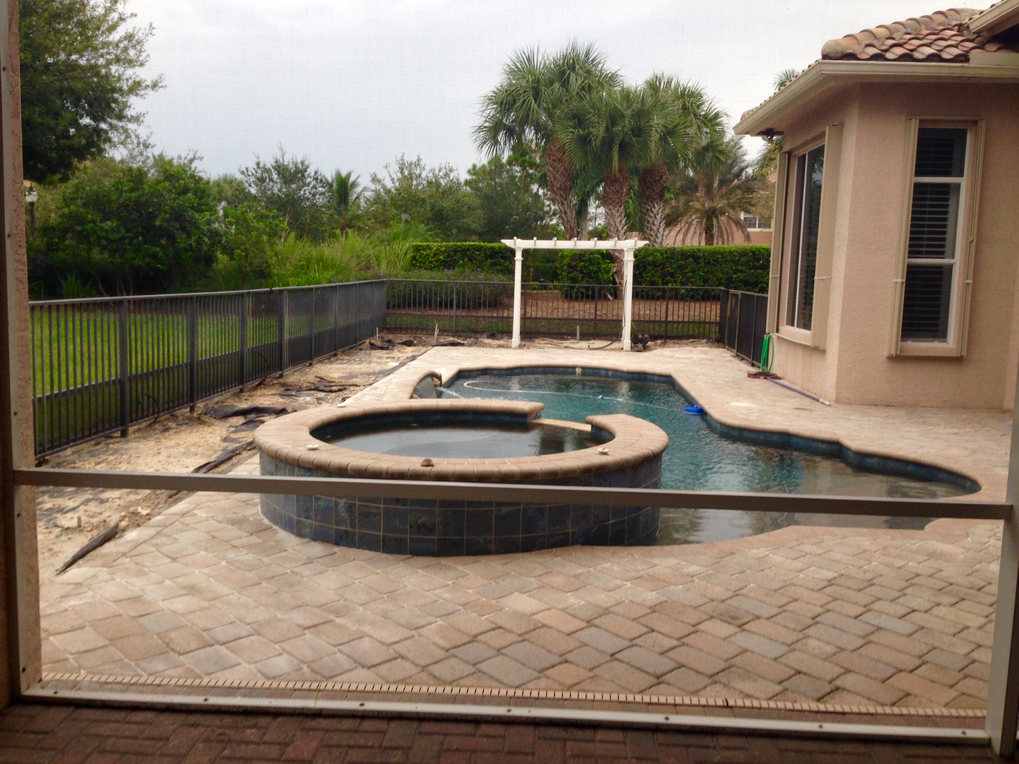 Tropical landscaping and paver deck for small pool area for Pool redesign